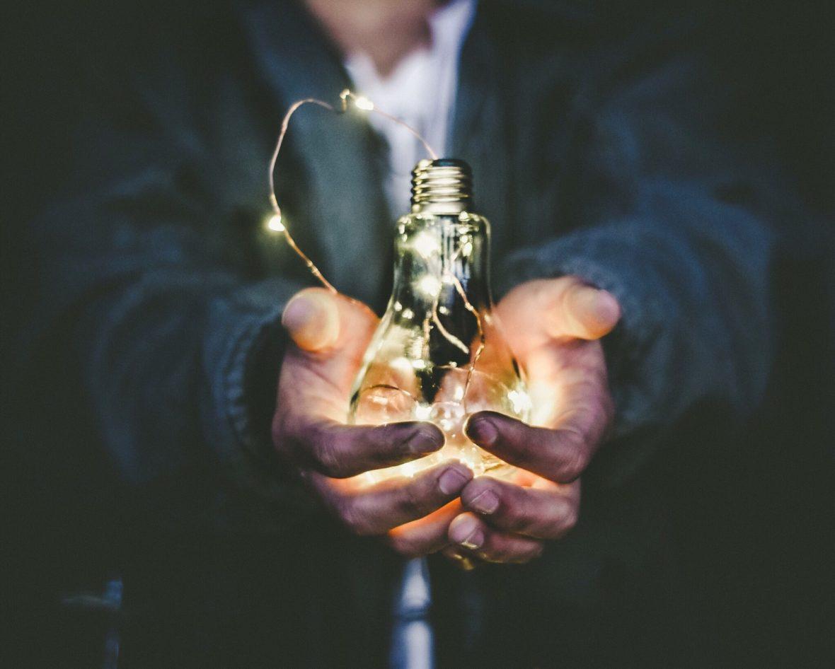 Person holding lightbulb. Riccrado Annandale, Unsplash.